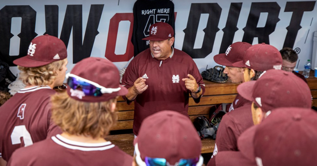 OMAHA, NE - June 22, 2021 - Mississippi State Head Coach Chris Lemonis speaks to the team in the dugout during the 2021 Mens College World Series game between the Mississippi State Bulldogs and the Virginia Cavaliers at TD Ameritrade Park in Omaha, NE. Photo By Austin Perryman
