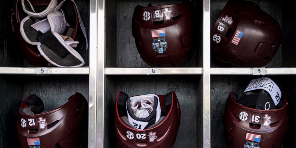 OMAHA, NE - June 25, 2021 - Batting helmets in the dugout before the 2021 Mens College World Series semifinal round game between the Texas Longhorns and the Mississippi State Bulldogs at TD Ameritrade Park in Omaha, NE. Photo By Austin Perryman
