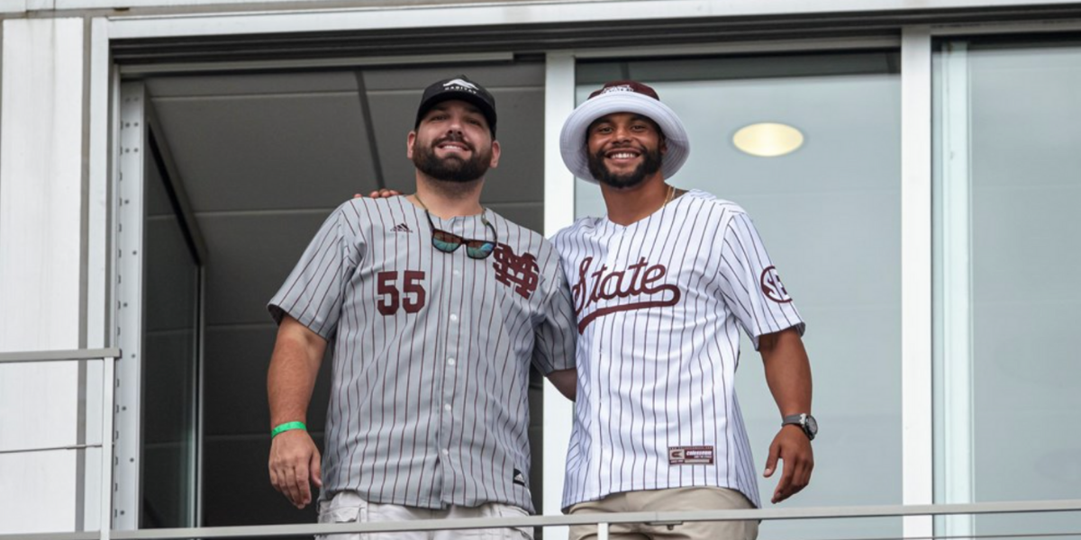 OMAHA, NE - June 29, 2021 - Mississippi State Alums Ben Beckwith and Dak Prescott pose before game 2 of the 2021 Mens College World Series national championship series between the Vanderbilt Commodores and the Mississippi State Bulldogs at TD Ameritrade Park in Omaha, NE. Photo By Austin Perryman