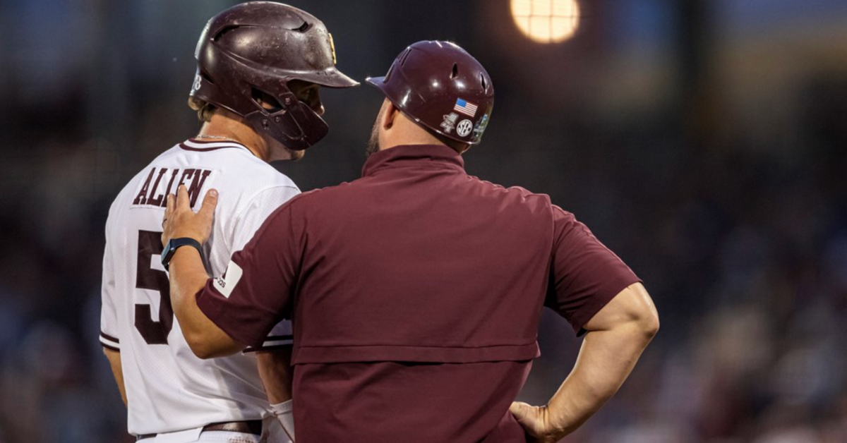 OMAHA, NE - June 29, 2021 - Mississippi State Outfielder Tanner Allen (#5) and Baseball Camps Coordinator/Volunteer Assistant Kyle Cheesebrough during game 2 of the 2021 Mens College World Series national championship series between the Vanderbilt Commodores and the Mississippi State Bulldogs at TD Ameritrade Park in Omaha, NE. Photo By Austin Perryman